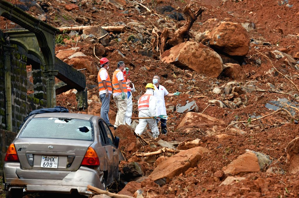 FREETOWN, Aug. 17, 2017 - Members from China Railway Seventh Group and Chinese Medical Team work at the mudslide site in Freetown, Sierra Leone, on Aug. 17, 2017. Chinese companies and medical team ...