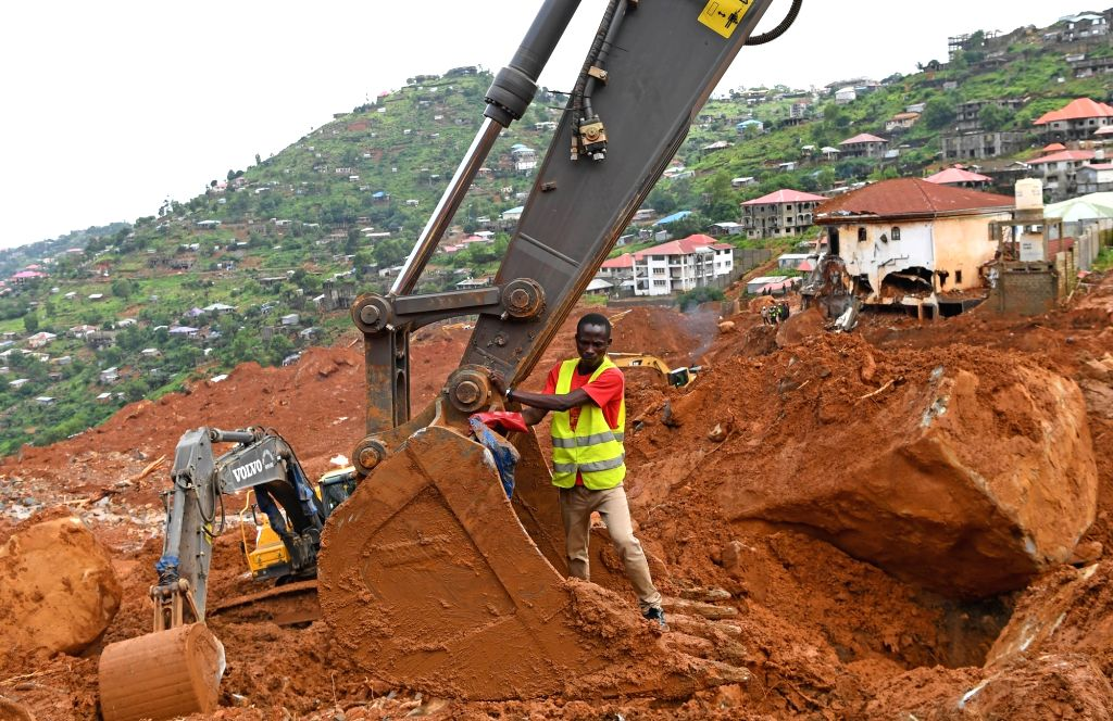 FREETOWN, Aug. 17, 2017 - Rescuers utilize a digging machine to clear the debris on the site of the mudslide in Freetown, capital of Sierra Leone, on Aug. 17, 2017. Altogether 331 bodies have been ...