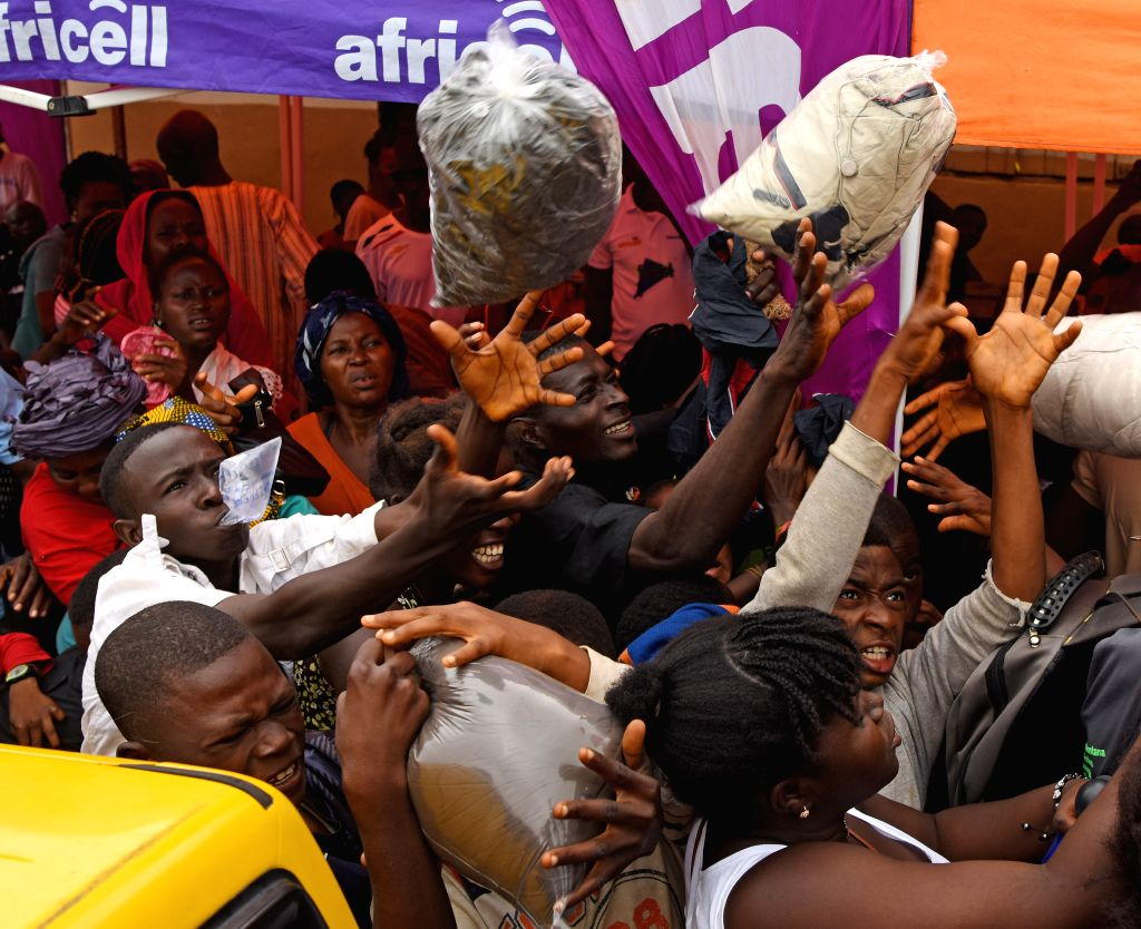 FREETOWN, Aug. 20, 2017 - People get clothes at the Saio Elementary Community School after the mudslides in Freetown, capital of Sierra Leone, on Aug. 19, 2017. The UN Office for the Coordination of ...