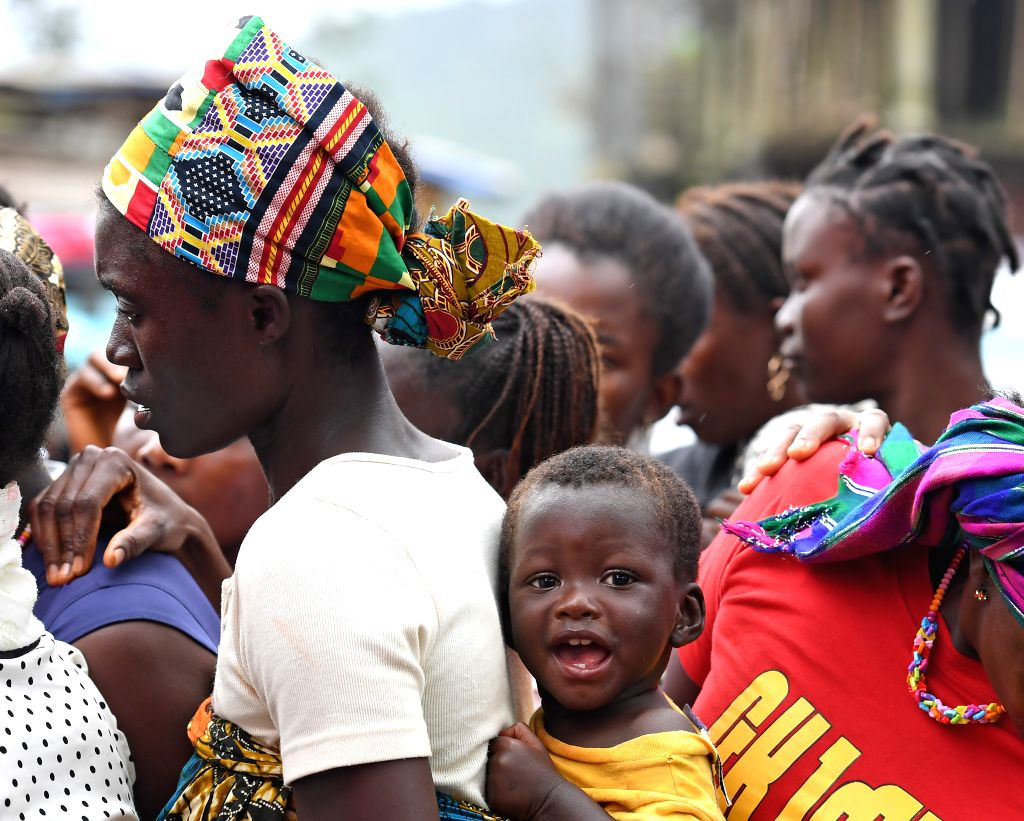 FREETOWN, Aug. 20, 2017 - People queue to get food and drinking water at the Saio Elementary Community School after the mudslides in Freetown, capital of Sierra Leone, on Aug. 19, 2017. The UN Office ...