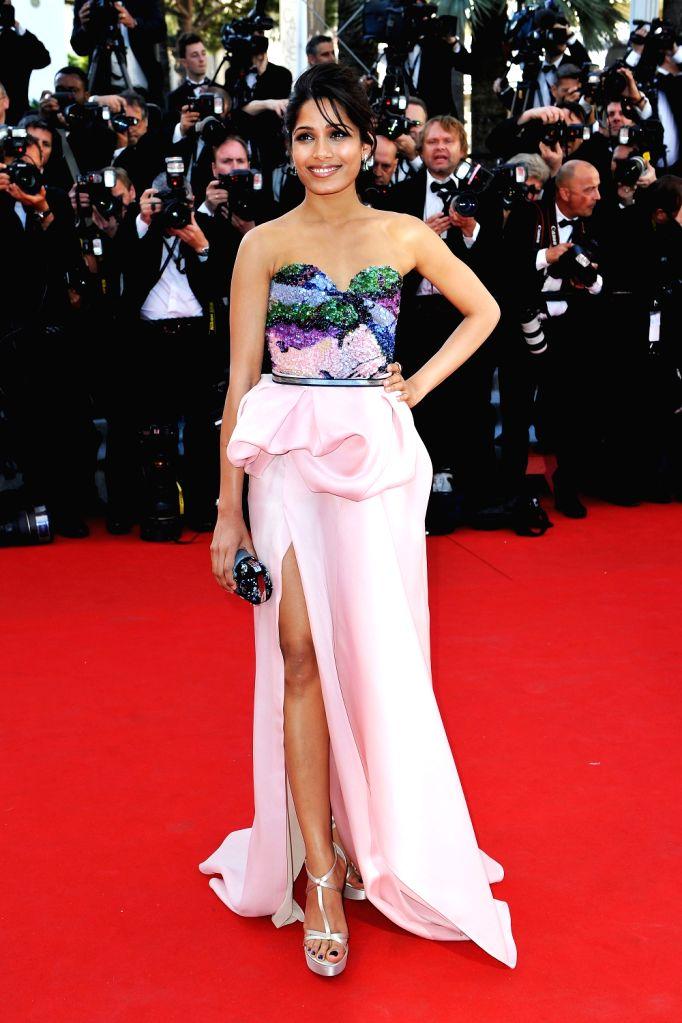 Freida Pinto walking the red carpet of Cannes Film Festival.