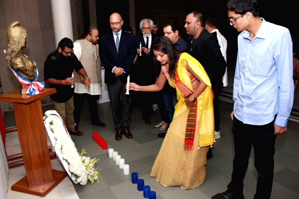 French Ambassador to India Francois Richier and FDCI president Sunil Sethi with prominent fashion designers of India pay tribute to the victims of 13/11 Paris blasts in New Delhi on Nov ...