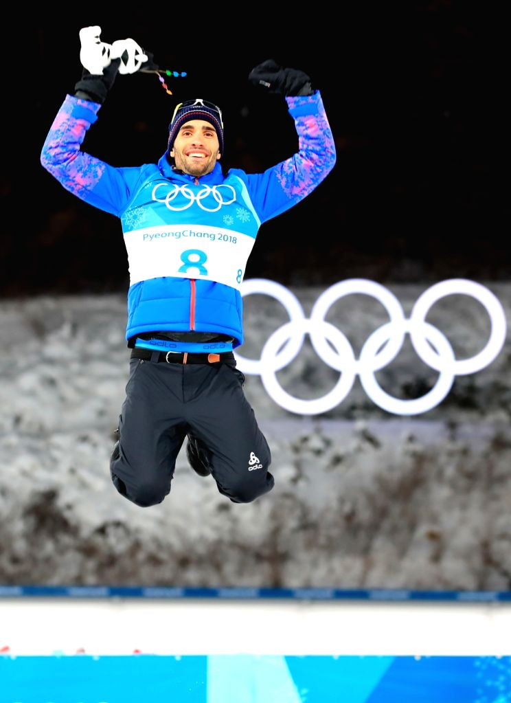 French biathlete Martin Fourcade celebrates after winning the gold medal in the men's 12.5km pursuit finals during the PyeongChang Winter Olympics at Alpensia Biathlon Centre in ...