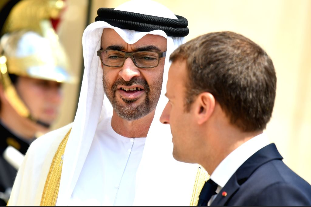 French President Emmanuel Macron (R) meets with Abu Dhabi Crown Prince Sheikh Mohammed bin Zayed Al-Nahyan at the Elysee Palace in Paris June 21, 2017.