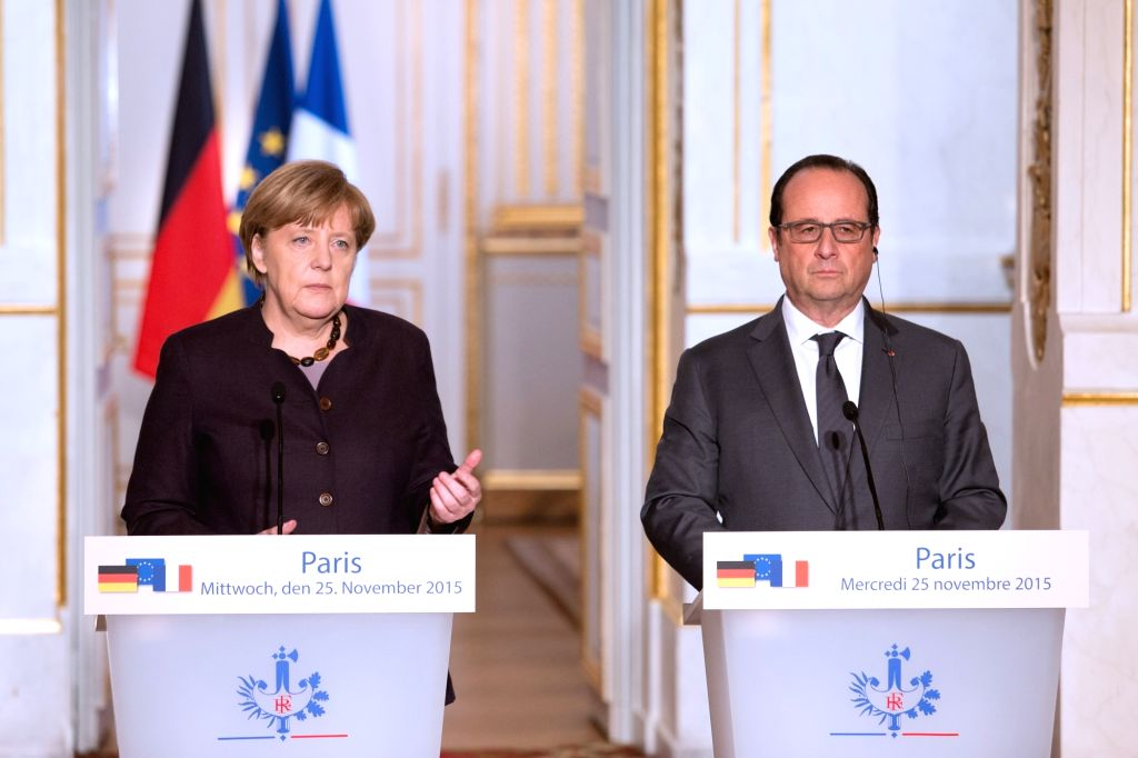 French President Francois Hollande(R) and German Chancellor Angela Merkel deliver a joint statement after a meeting at the presidential Elysee Palace in Paris, ...