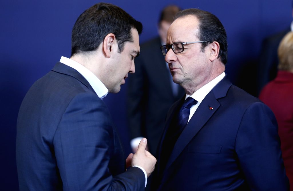 French President Francois Hollande (R) and Greek Prime Minister Alexis Tsipras talk during a photo session at the start of an EU-Turkey Summit in Brussels, ... - Alexis Tsipras