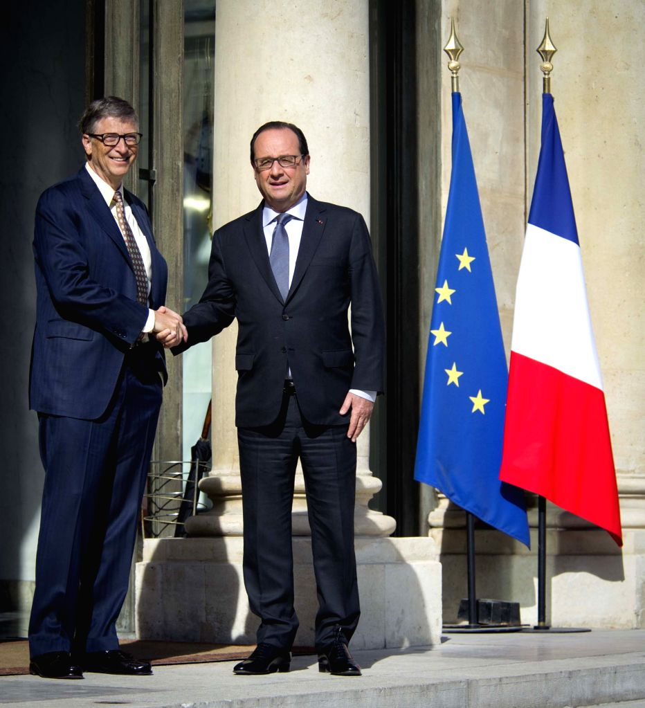 French President Francois Hollande (R) shakes hands with Microsoft founder Bill Gates, co-chair of the Bill & Melinda Gates Foundation, after their meeting at the ...