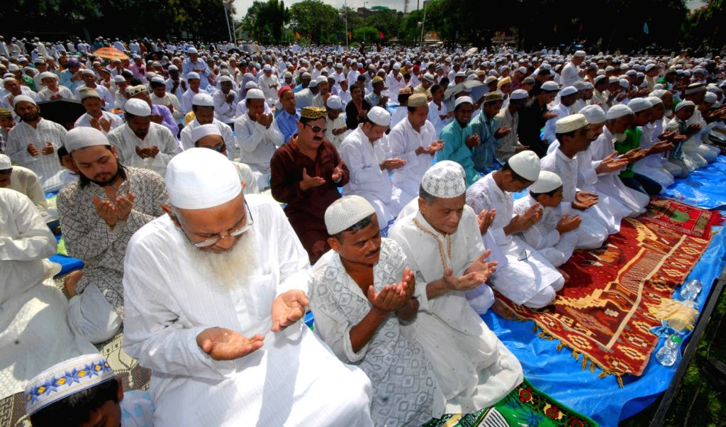 Friends and near ones wishing Eid Mubarak after offering their Eid prayers to mark the end of Holy month of Ramadan at the Hatigaon Eidgah in Guwahati on August 9, 2013.