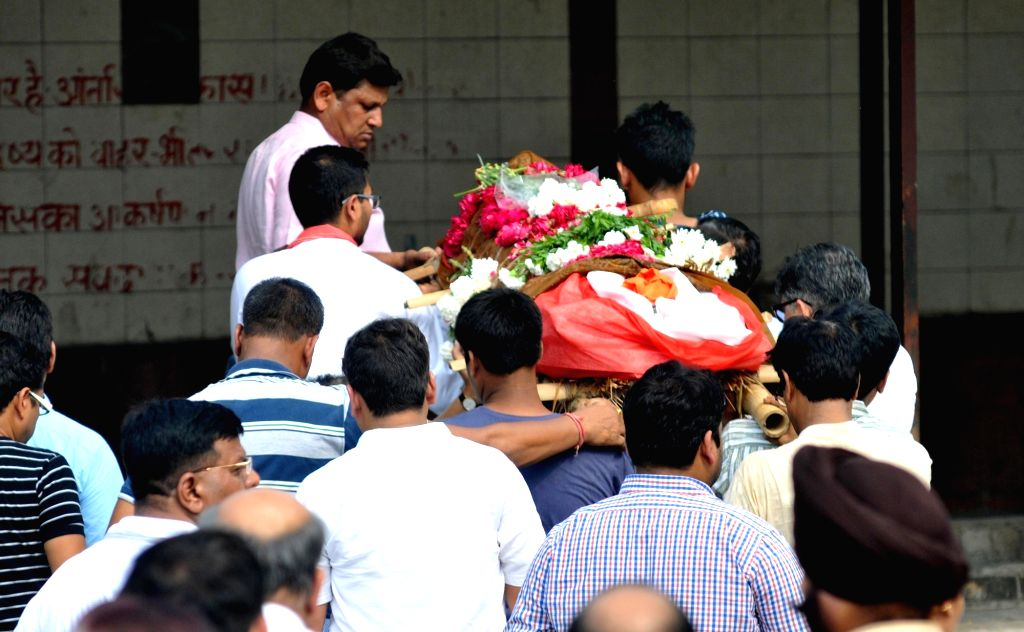 Friends and relatives of 19-years-old Tarishi Jain, who was among the 20 hostages killed in a gruesome terror attack in Dhaka participate in her last rites; in Gurgaon on July 4, 2016. - Tarishi Jain