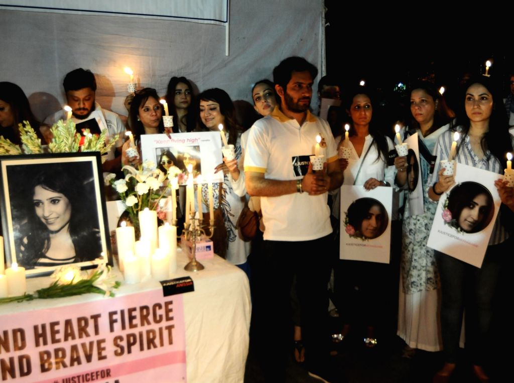 Friends and relatives of 39-year-old air hostess Anissia Batra, who allegedly committed suicide last month participate in a candle light march to demand justice for her, at Parliament ...