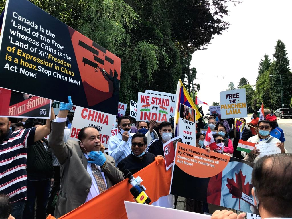 Friends of India' organization holds a protest outside the Chinese Consulate in Vancouver demanding the release of detained Canadians in China, on July 5, 2020.