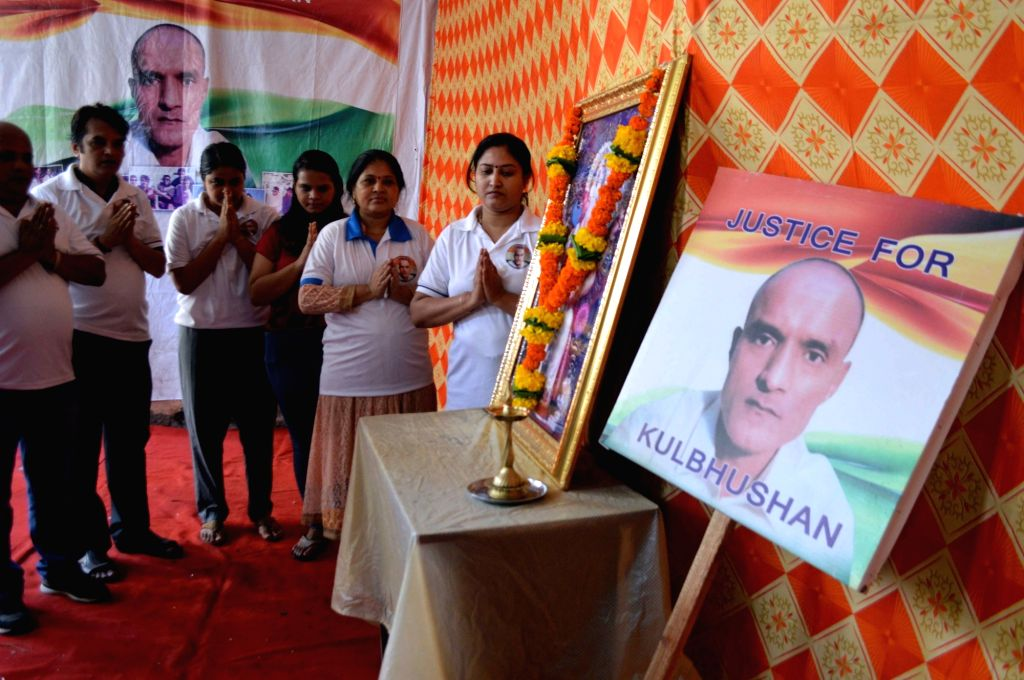 Friends of Kulbhushan Jadhav, a Mumbaikar who is facing death sentence in Pakistan, pray for his release, in Mumbai on July 17, 2019. The International Court of Justice (ICJ) will deliver its ...