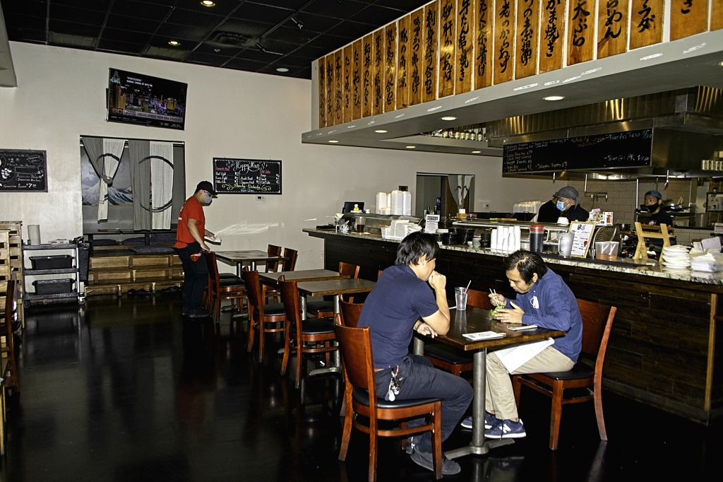 Frisco (U.S.), Sept. 21, 2020 Customers dine in a Japanese restaurant in Frisco, Texas, the United States, on Sept. 21, 2020. Governor of the U.S. state of Texas Greg Abbott announced ...