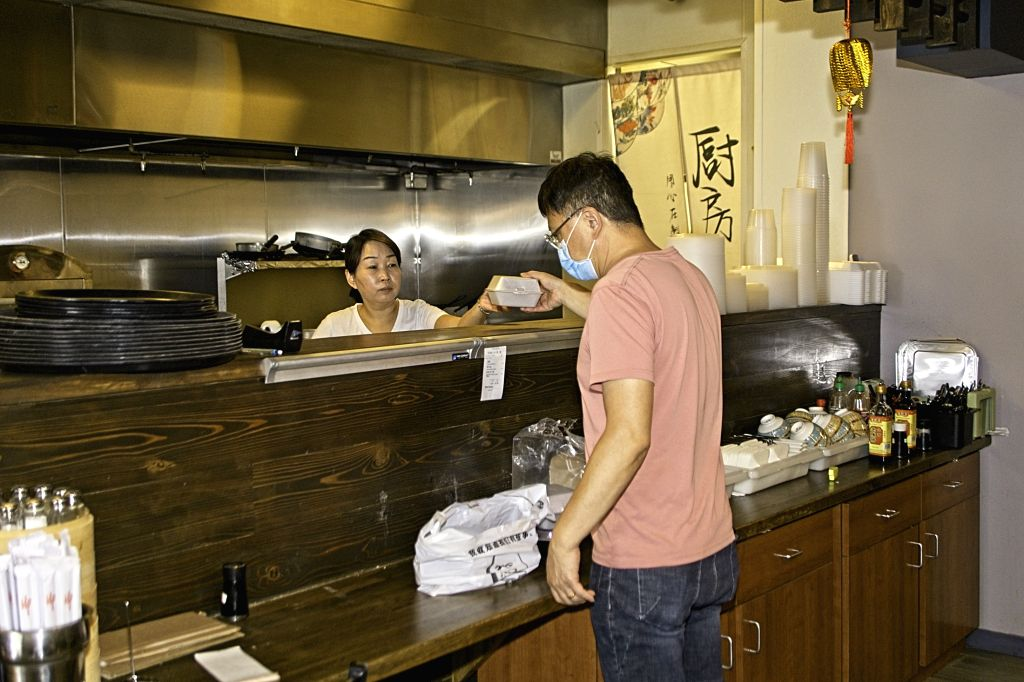 Frisco (U.S.), Sept. 21, 2020 Staff members prepare a take-out order in a Chinese restaurant in Frisco, Texas, the United States, on Sept. 21, 2020. Governor of the U.S. state of Texas ...