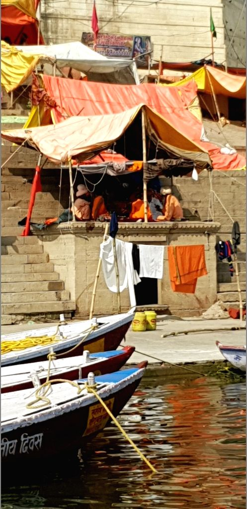 From Benaras to Prayag, it is a Sangam of Faith. Ascetics seen sitting in their makeshift tents on the banks of the Ganga river.