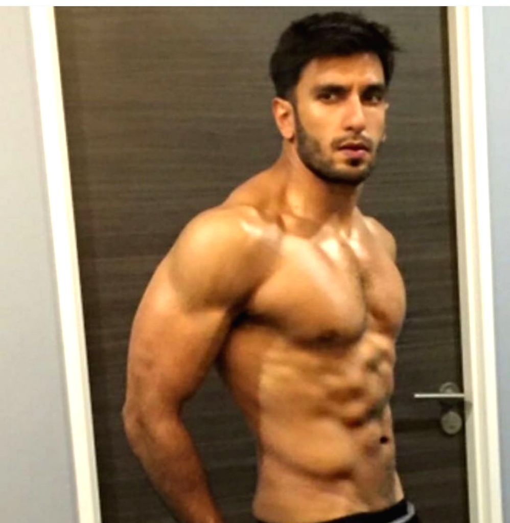 """From his debut film """"Band Baaja Baaraat"""" to his latest hits """"Simmba""""  and """"Gully Boy"""", actor Ranveer Singh has been wooing the audience not only with his feisty screen presence and acting skills, but also with his look -- particularly his toned, fit  - Ranveer Singh and Kapil Dev"""