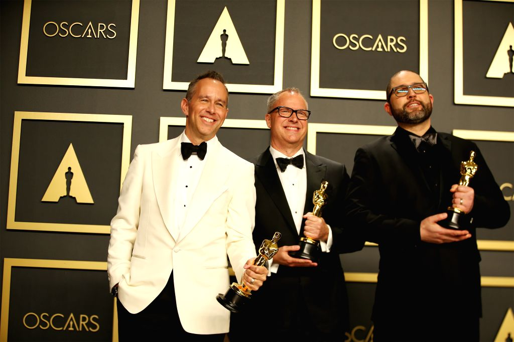 """(From L to R)Jonas Rivera, Mark Nielsen and Josh Cooley pose for photos after winning the Best Animated Feature Film award for """"Toy Story 4"""" at the ..."""