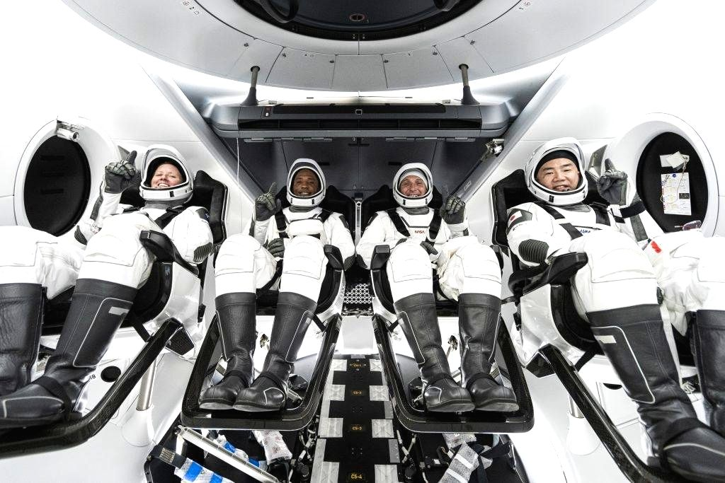 From left, NASA astronauts Shannon Walker, Victor Glover, Michael Hopkins and Japan Aerospace Exploration Agency astronaut Soichi Noguchi are seated in SpaceX's Crew Dragon spacecraft during crew equipment interface training. (Photo Courtesy: NASA)