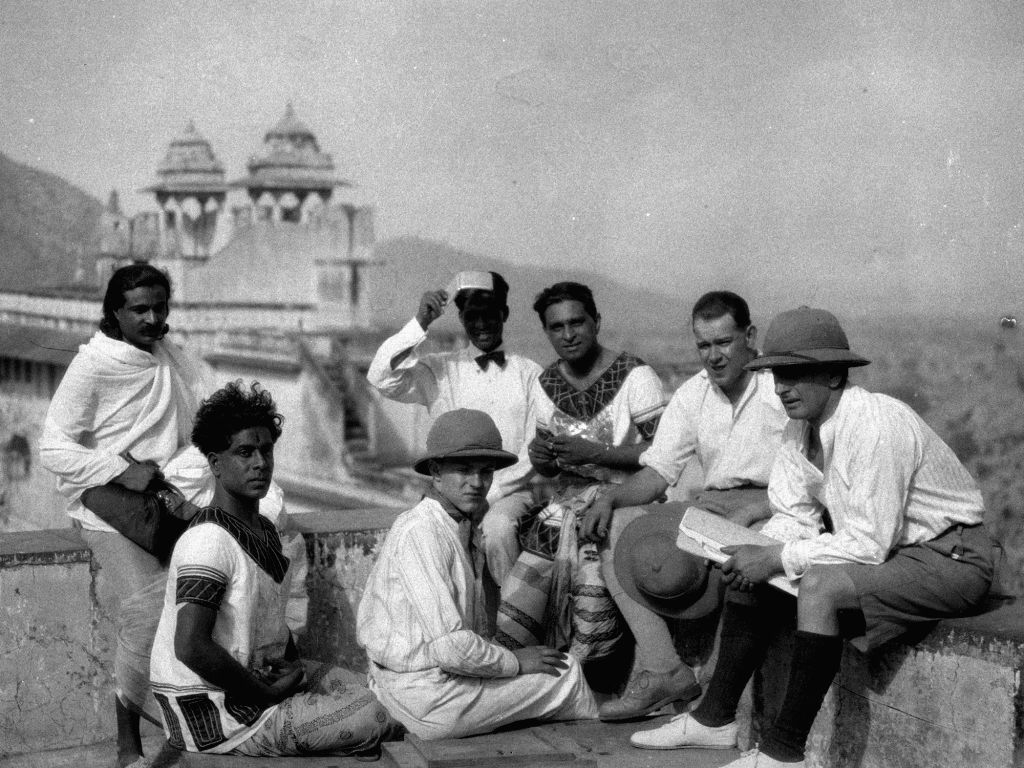 (From right) Barthe Schultes, Josef Wirsching, Himashu Rai, Niranjan Pal, Willie Keirmaier, Modhu Bose and an extra seated atop the ramparts of the Jaipur palace. - Himashu Rai and Modhu Bose