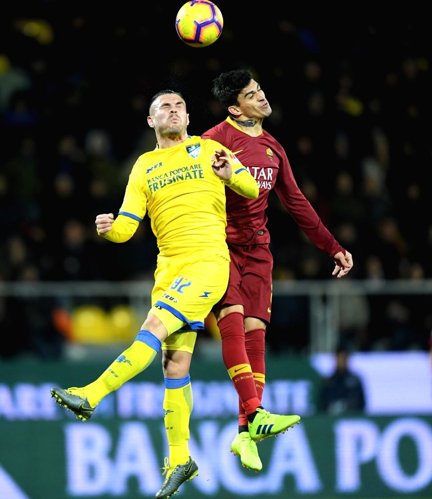 FROSINONE, Feb. 24, 2019 - Roma's Diego Perotti (R) vies with Frosinone's Federico Viviani during a Italian Serie A soccer match between Frosinone and Roma in Frosinone Italy, Feb. 23 , 2019. Roma ...