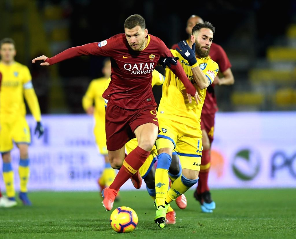 FROSINONE, Feb. 24, 2019 - Roma's Edin Dzeko (L) vies with Frosinone's Francesco Zampano during a Italian Serie A soccer match between Frosinone and Roma in Frosinone Italy, Feb. 23 , 2019. Roma won ...