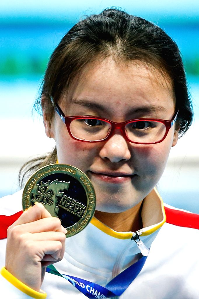 Fu Yuanhui of China displays her gold medal after the awarding ceremony of the women's 50m backstroke final at the 2015 FINA World Championships in Kazan, Russia, Aug. ...
