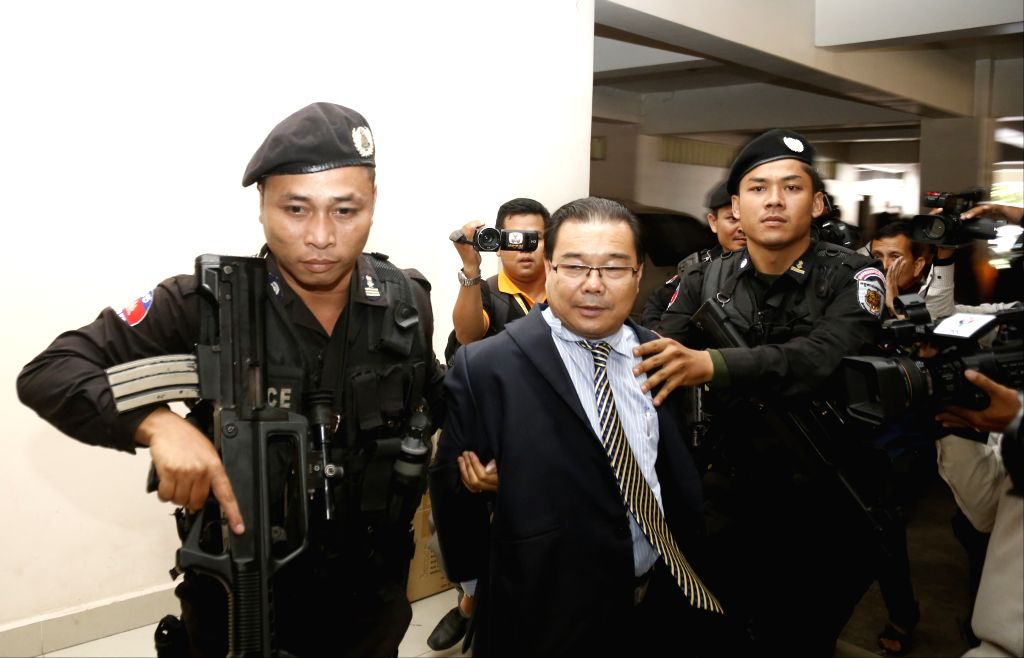 Fugitive Cambodian opposition senator Hong Sok Hour (C, front) is brought to Phnom Penh Municipal Court in Phnom Penh, Cambodia, Aug. 15, 2015. Fugitive ... - Hun Sen