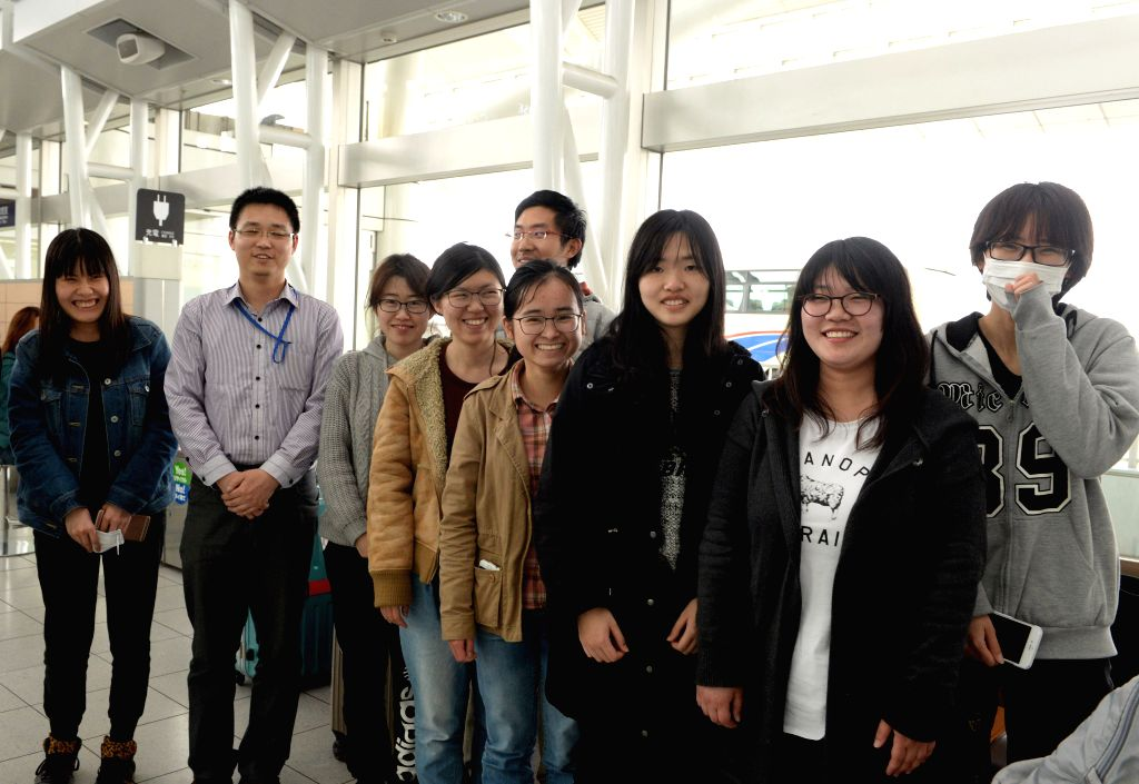 FUKUOKA, April 18, 2016 - Chinese overseas students pose for photos at the airport in Fukuoka, Japan, April 18, 2016. The Chinese Consulate in Japan's Fukuoka confirmed Monday that it had evacuated ...