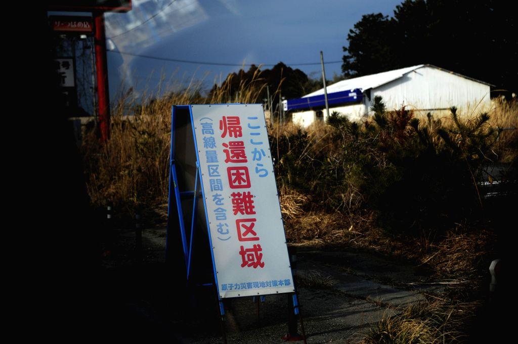 FUKUSHIMA(JAPAN), Feb. 25, 2017 (Xinhua) -- Photo taken on Feb. 22, 2017 shows a warning sign at Okuma near the Fukushima Daiichi nuclear power plant, Fukushima Prefecture, Japan. A magnitude-9.0 earthquake in 2011 triggered a massive tsunami which d
