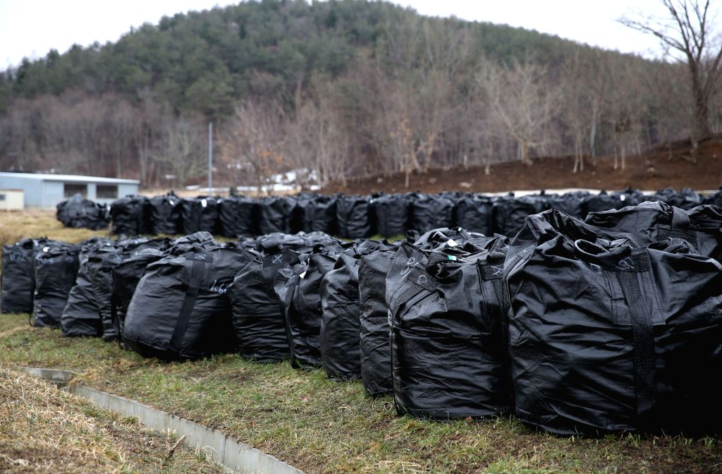 Black bags containing buildup of contaminated wastes are seen in the town of Iitate, Fukushima Prefecture, Japan, March 7, 2015. The scenes from the towns and ...