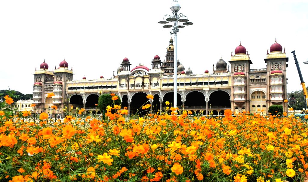 Fully blossomed colorful flowers seen in the lush green lawns of the Mysuru Palace ahead of Dasara festivities, in Mysuru on Oct 13, 2020.
