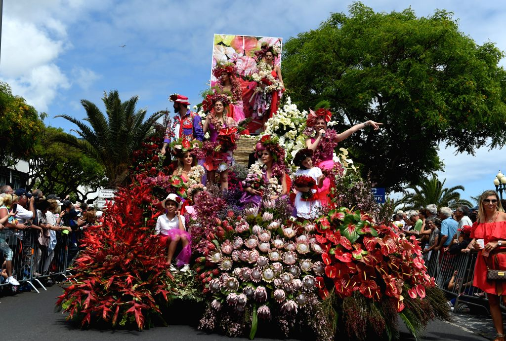 FUNCHAL, May 8, 2017 - Revelers perform during the grand parade of the Flower Festival in the city center of Funchal, capital of Madeira Autonomous Region, Portugal, on May 7, 2017. (Xinhua/Zhang ...