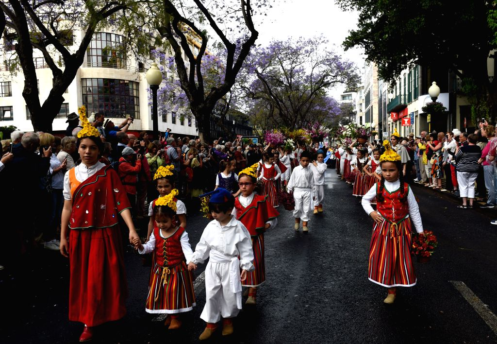 """FUNCHAL(PORTUGAL), May 7, 2017 People attend a parade towards the """"Wall of Hope"""" during the Madeira Flower Festival in Funchal, capital of Madeira Autonomous Region, Portugal, ..."""