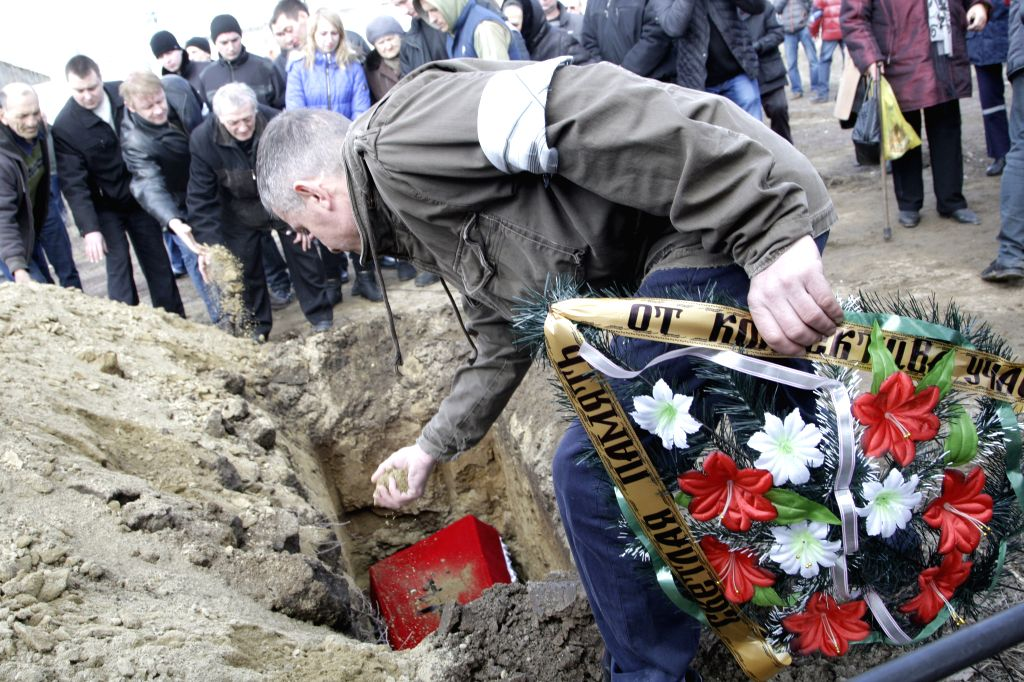 Funeral ceremony (Scheglovskoe cemetary) of seven miners, who was killed by explosion at Zasiadko mine.