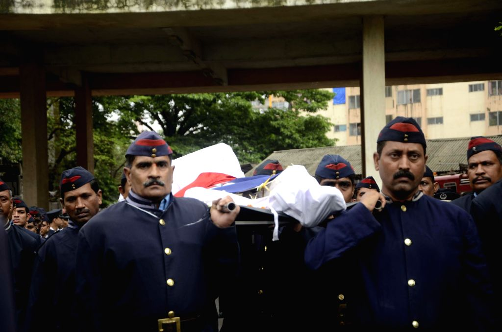 Funeral of fireman Nitin Yevlekar, who was killed dousing flames at the 22-storeyed Lotus Park building where a fire broke out yesterday (18th July 2014), at Fire Brigade Head Quarters in Mumbai on ..