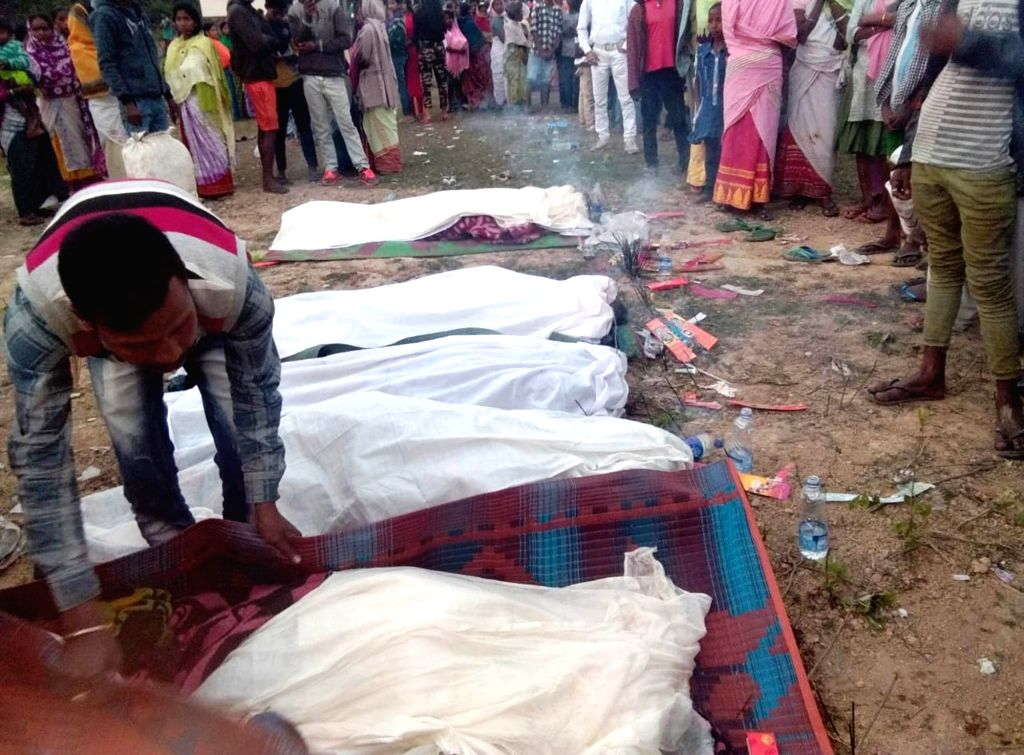 Funeral of those killed after consuming spurious liquor underway in Assam's Golaghat district on Feb 22, 2019. At least 22 persons have died and over 30 others taken ill after consuming ...