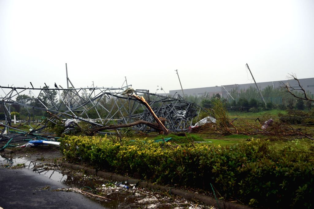 FUNING, June 23, 2016 - Photo taken on June 23, 2016 shows a tornado-damaged power pole in Funing County, east China's Jiangsu Province. A tornado hit Funing County Thursday afternoon.   (Xinhua/Yang ...