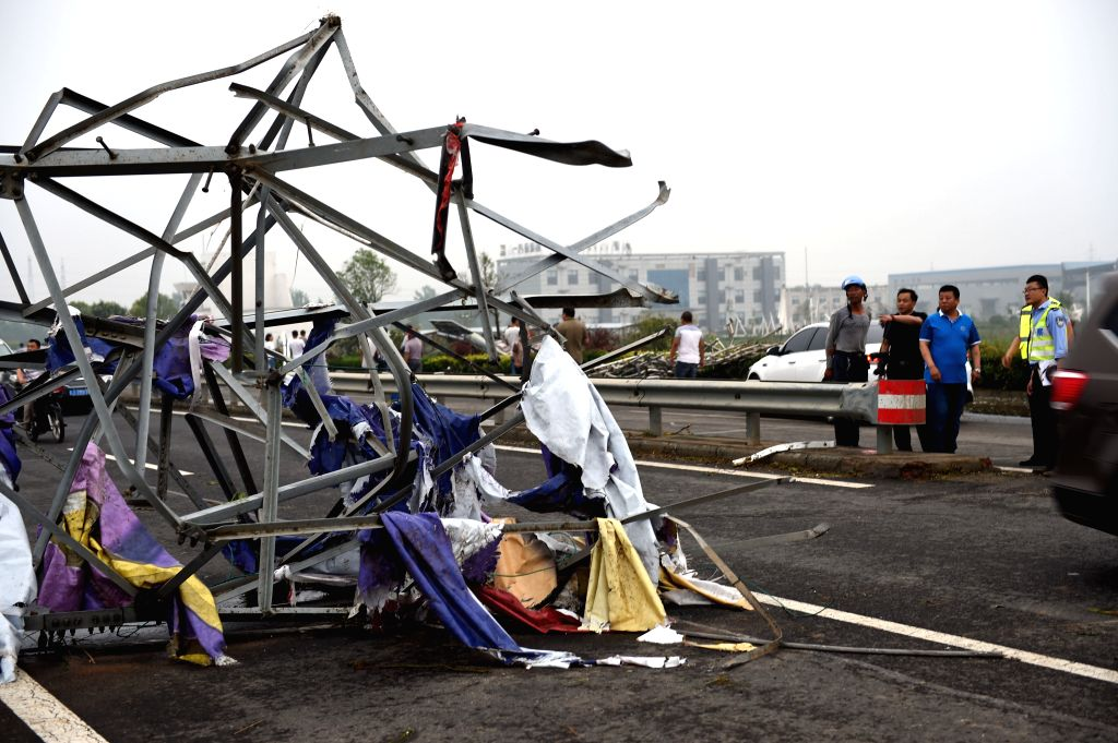 FUNING, June 23, 2016 - Photo taken on June 23, 2016 shows a steel tower blown down by tornado in Funing County, east China's Jiangsu Province. A tornado hit Funing County Thursday afternoon.   ...