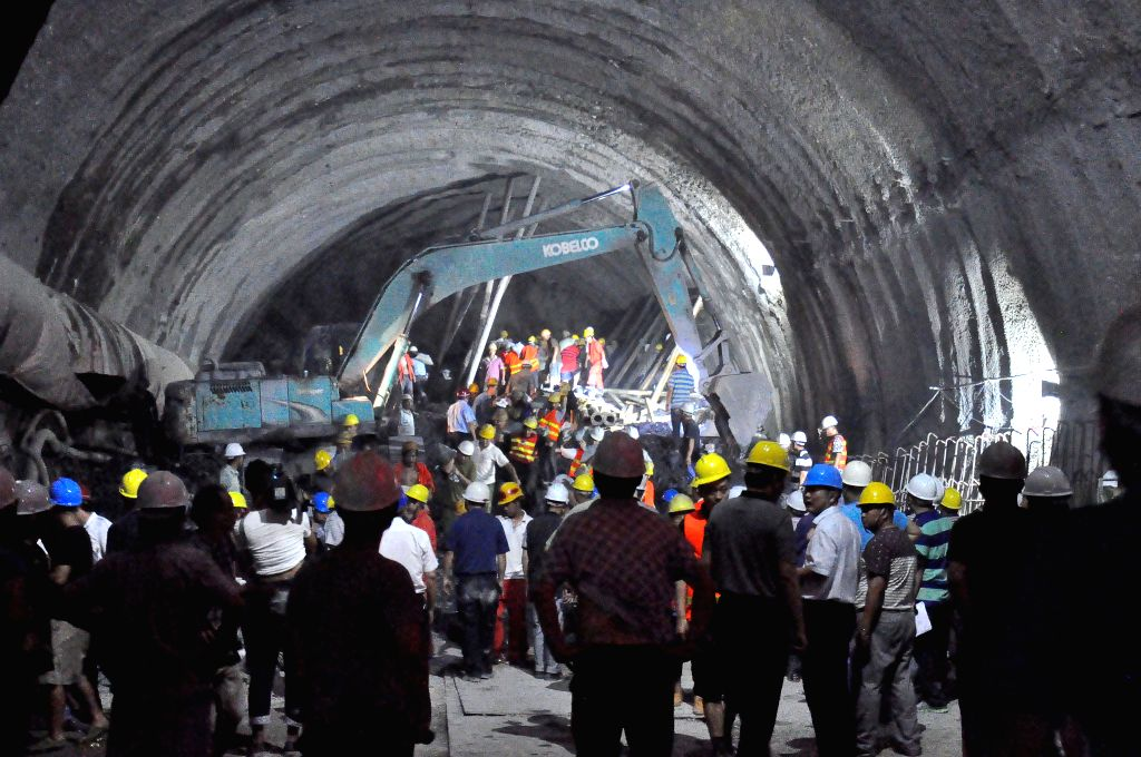 FUNING(YUNNAN), July 15, 2014 Rescuers work in a collapsed railway tunnel in Funing, southwest China's Yunnan Province, July 15, 2014. Rescuers were working all out Monday night hoping to