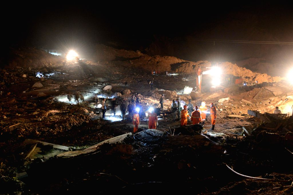 Rescuers work at the site of landslide in Yingping Village of Daoping Town in Fuquan City of Qiannan Prefecture, southwest China's Guizhou Province, Aug. 28, 2014. ..