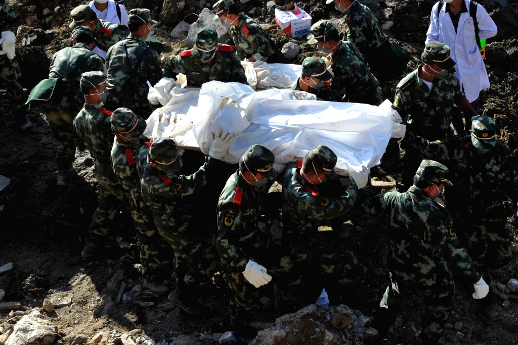 Soldiers carry the body of a victim of a landslide in Yingping Village of Daoping Township, Fuquan City, southwest China's Guizhou Province, Aug. 30, 2014. Nineteen .