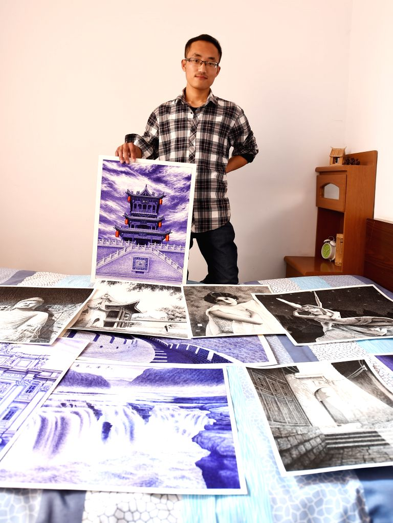 23-year-old painter Liu Kai shows his ball pen pictures at home in Fushan County, north China's Shanxi Province, March 17, 2015. After graduating from high school, ...