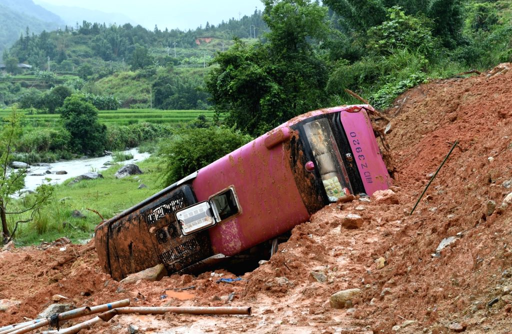 FUZHOU, Aug. 13, 2016 - Photo taken on Aug. 13, 2016 shows the accident site in Longyan, southeast China's Fujian Province. A Taiwanese woman died and several other tourists were injured when a bus ...
