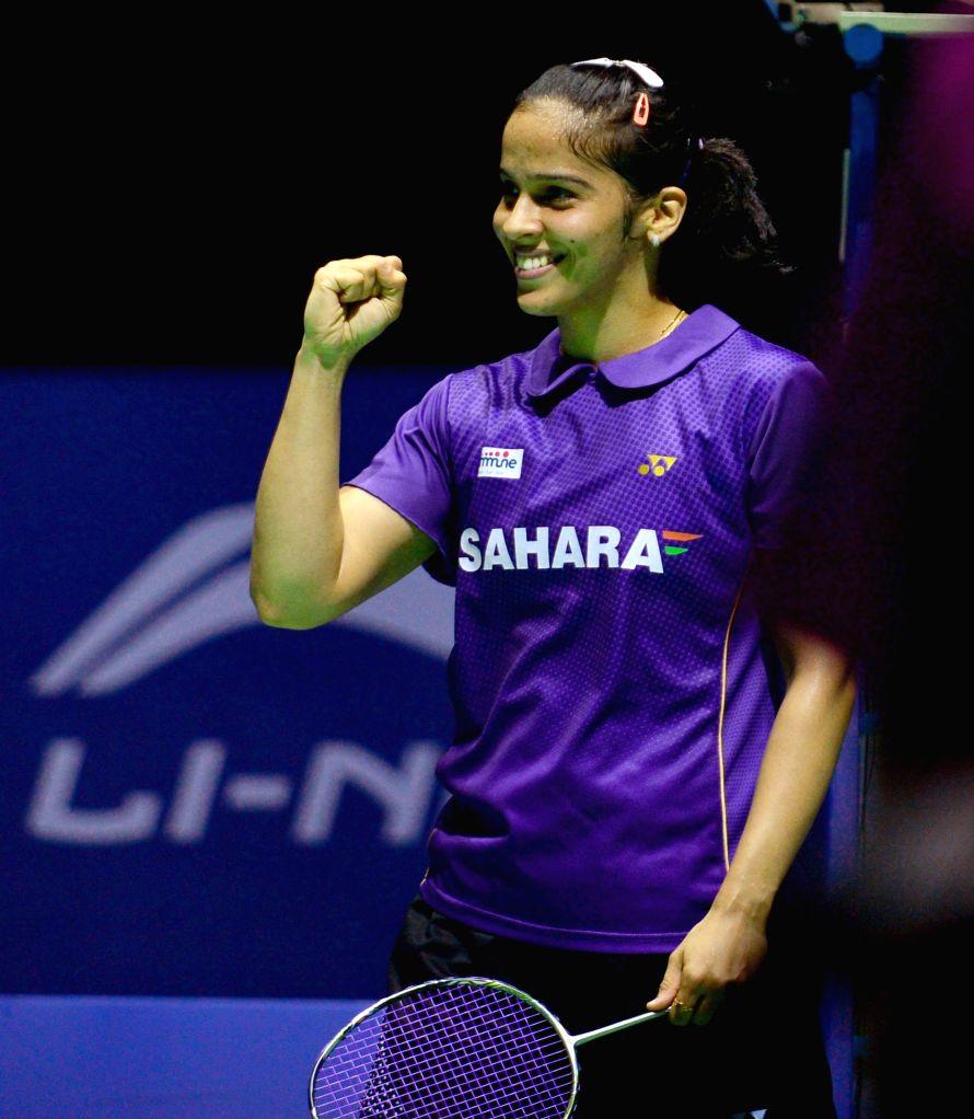 Indian shuttler Saina Nehwal after winning her maiden China Open Super Series Premier women's singles title in Fuzhou, China on Nov 16, 2014. Saina defeated Japan's Akane Yamaguchi. Score 2-0.