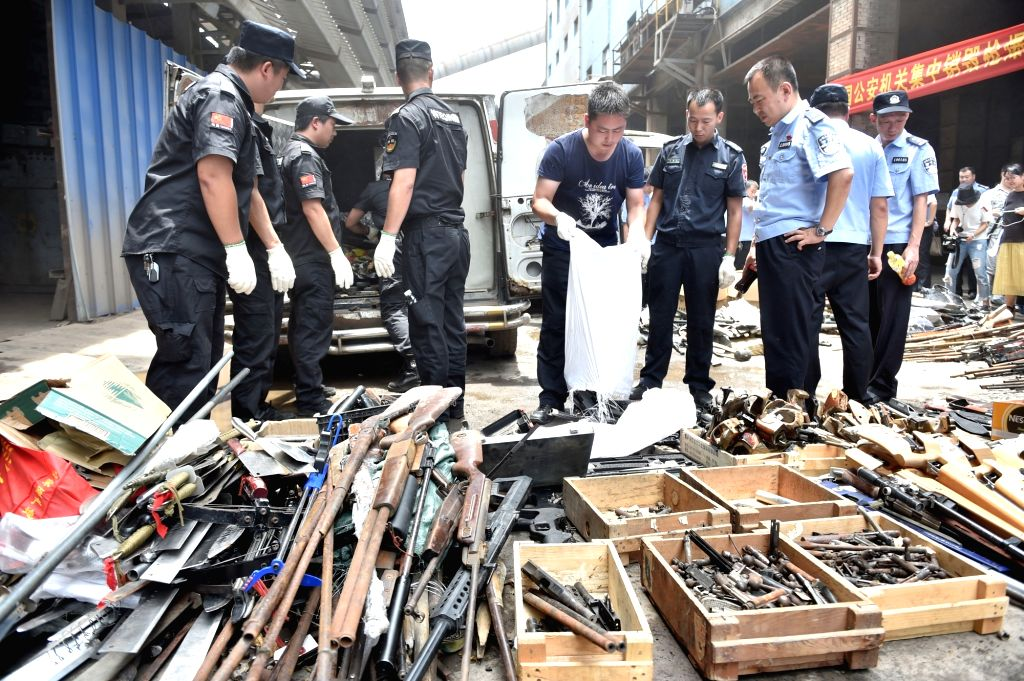 FUZHOU, July 6, 2017 - Policemen prepare for the destruction of confiscated illegal arms in Fuzhou, capital of southeast China's Fujian Province, July 5, 2017. More than 2,600 guns, 63,000 rounds of ...