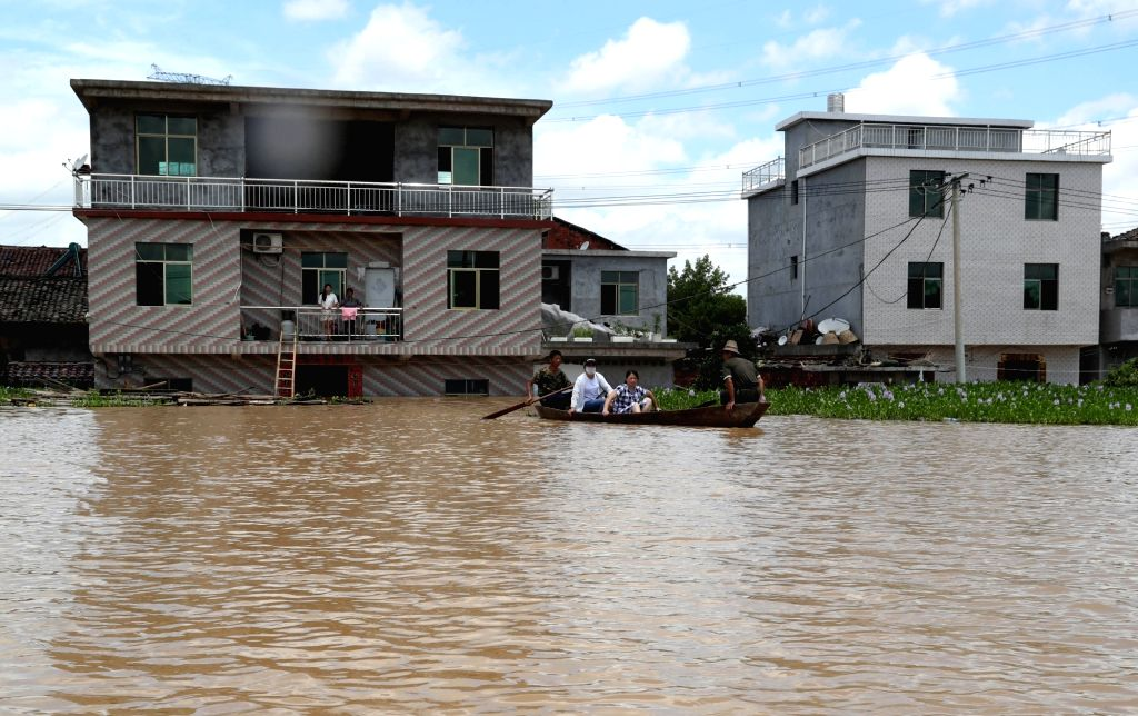 FUZHOU, July 9, 2018 - Residents take boat in flooded area in Qiaoxi Village of Maxu Township of Fuzhou City, east China's Jiangxi Province, July 8, 2018. Flood caused by heavy rain damaged crops and ...