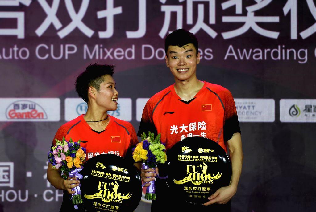 FUZHOU, Nov. 10, 2019 - Wang Yilyu (R)/Huang Dongping of China pose during the awarding ceremony after the mixed doubles final match between Wang Yilyu/Huang Dongping of China and Zheng Siwei/Huang ...