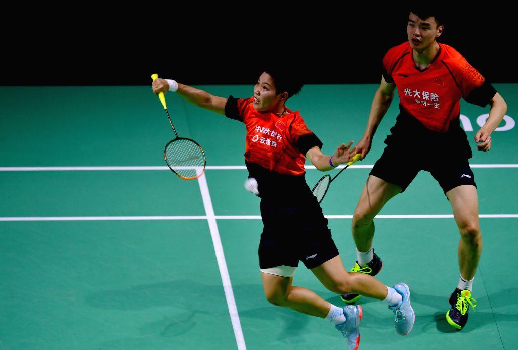 FUZHOU, Nov. 10, 2019 - Wang Yilyu (R)/Huang Dongping of China compete during the mixed doubles final match between Wang Yilyu/Huang Dongping of China and Zheng Siwei/Huang Yaqing of China at the ...