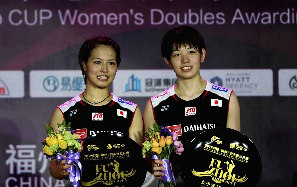 FUZHOU, Nov. 10, 2019 - Yuki Fukushima (L) /Sayaka Hirota of Japan pose during the awarding ceremony after the women's doubles final match between Yuki Fukushima/Sayaka Hirota of Japan and Lee So ...