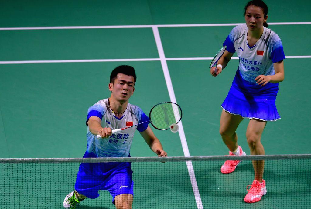 FUZHOU, Nov. 10, 2019 - Zheng Siwei (L)/Huang Yaqiong of China compete during the mixed doubles final match between Wang Yilyu/Huang Dongping of China and Zheng Siwei/Huang Yaqing of China at the ...